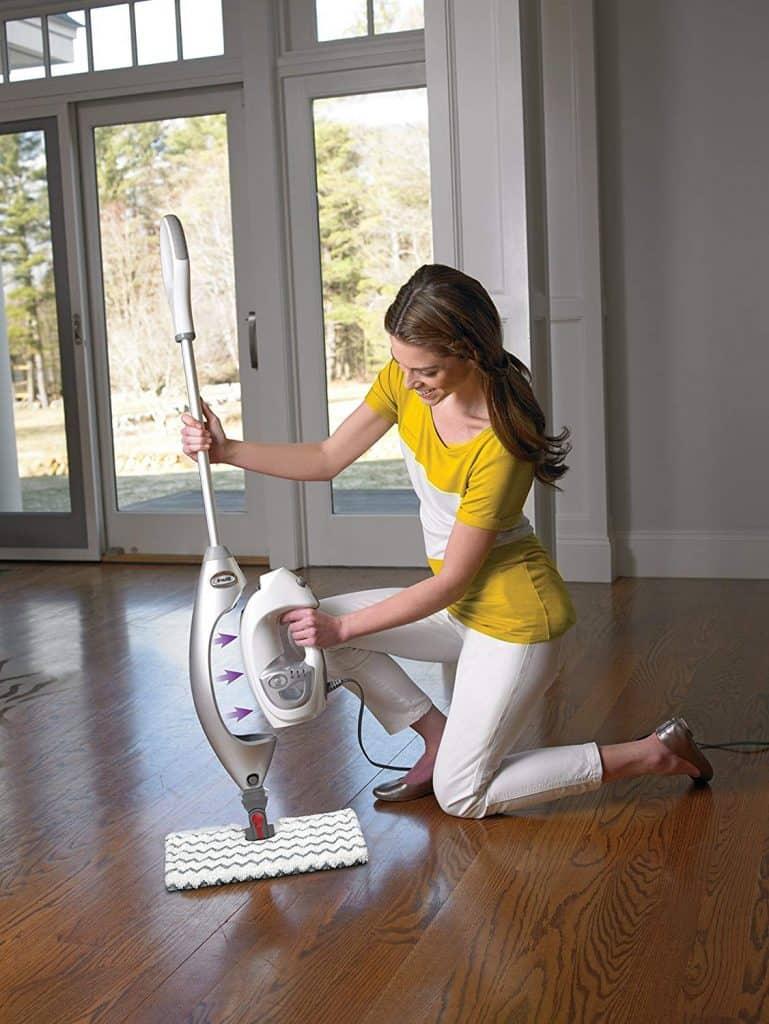 lady using shark lift-away pro steam pocket mop